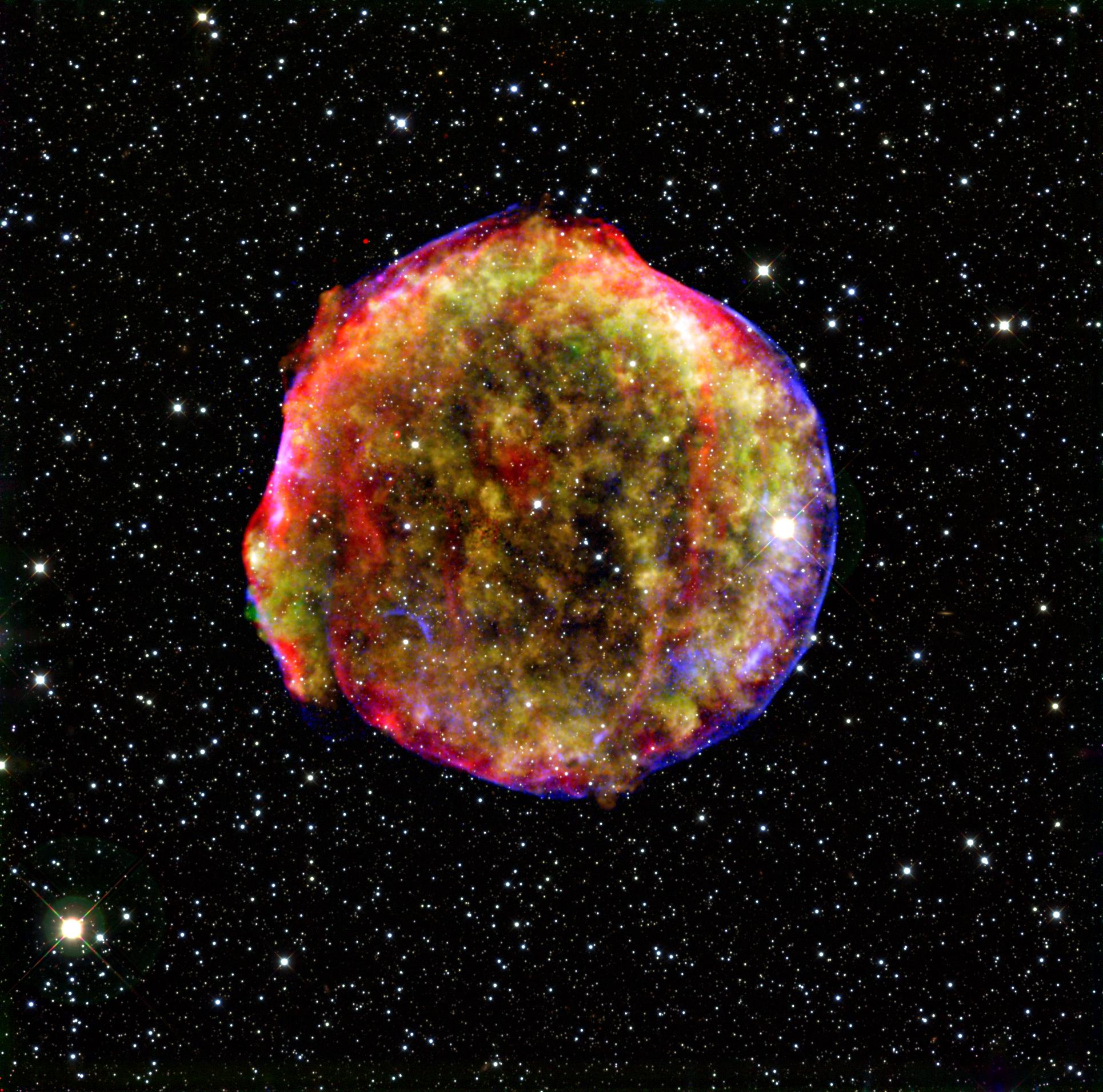 Multiwavelength composite image of the remnant of Tycho's supernova, SN 1572. Photo credit: NASA/MPIA/Calar Alto Observatory, Oliver Krause et al.