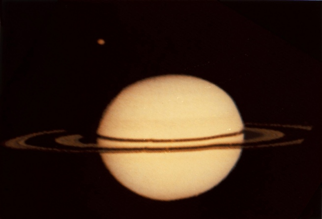 pioneer-11-image-of-saturn-and-its-moon-titan-1979