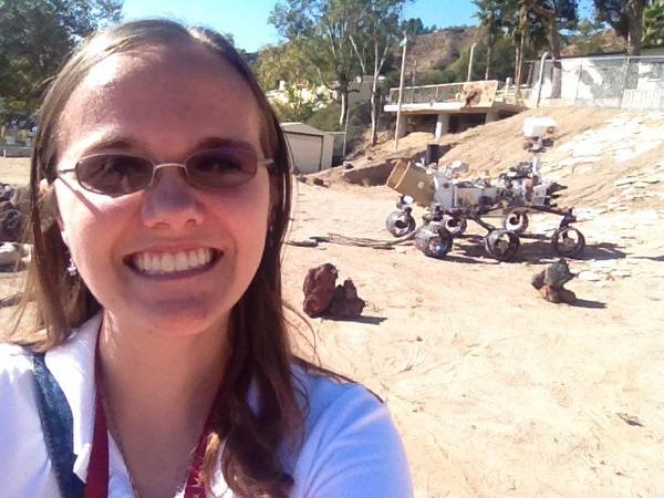 Keri Bean in the NASA JPL Mars Yard, with the Curiosity test-bed twin Maggie