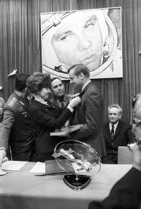 Valentina Tereshkova, presenting a badge to U.S. astronaut Neil Armstrong in memory of his visit to the Gagarin Cosmonaut Training Center in Star City.