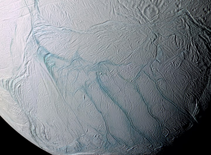 Enceladus and it's tiger stripes near the south pole (Image courtesy of NASA)