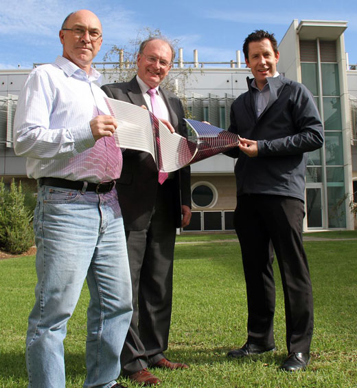 Dr David Jones, Professor Andrew Holmes and Dr Scott Watkins, three of the researchers involved, together with one of their printed solar cells.