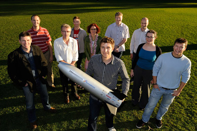 The University of Queensland Scramspace team with a smaller prototype of the 1.8m long hypersonic scramjet. Credit: University of Queensland